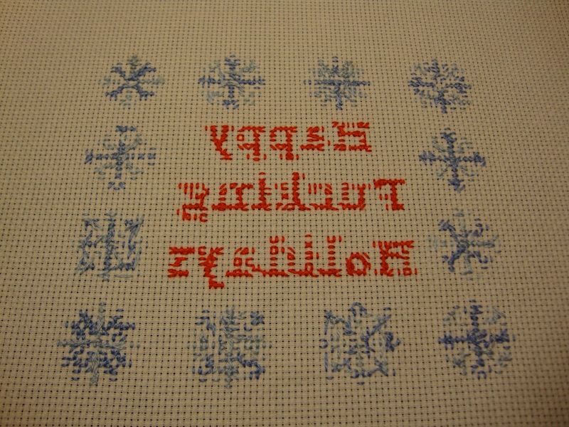 Backing of holiday cross stitch