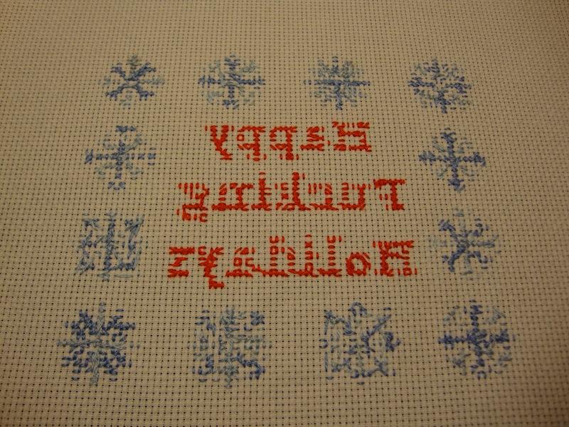 Backing of holiday cross stitch