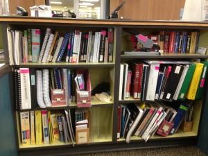 a 2/3 high shelf full of books