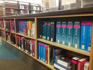 a half-high shelf full of books