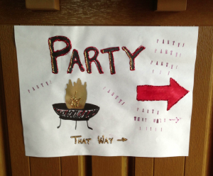 a sign with sparkles that says Party That Way with an arrow