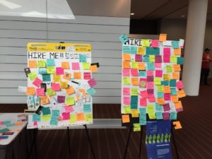 This photo shows two very full boards, one with 'HIRE ME' and the other with 'HIRING' - if you zoomed in, you'd see a lot of junior devs needing jobs and a lot of companies looking for higher level developers.