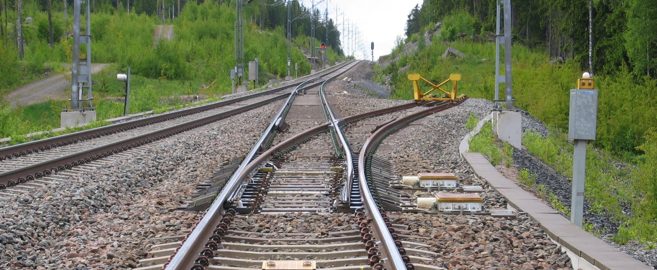 image shows railroad tracks with a switch to allow the train to go in one of two directions